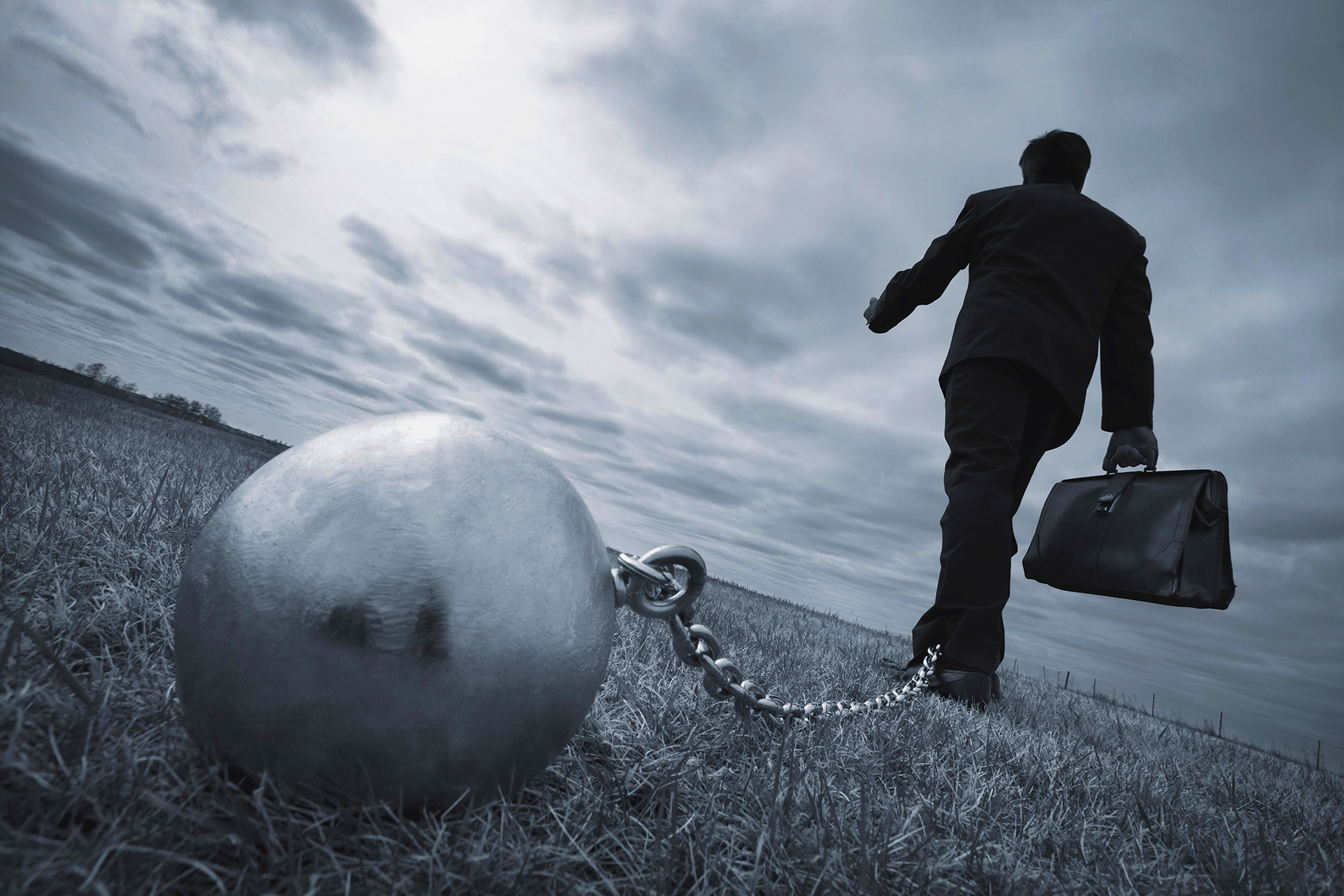 Ball and chain tied to ankle of business as representation of legal burden of proof